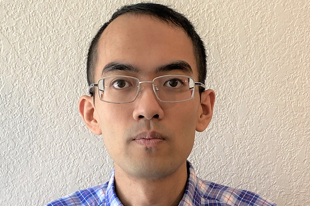 portrait of researcher with plain wall background